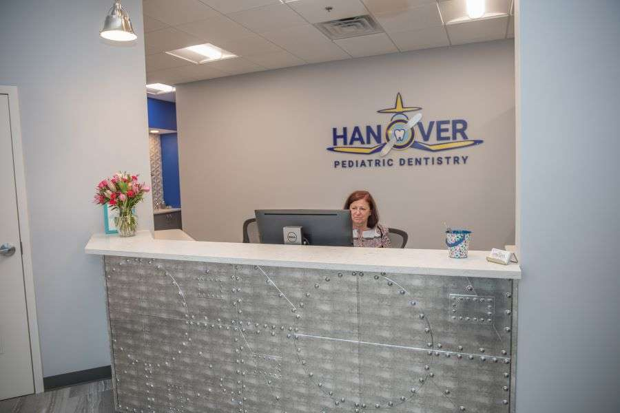 Working at the front desk Hanover Pediatric Dentistry