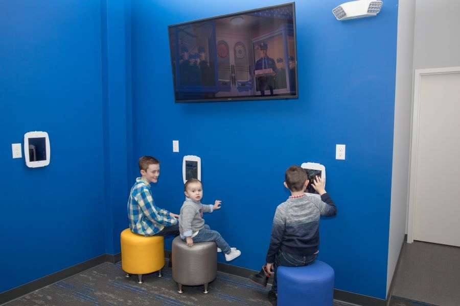 Young dental patients playing games