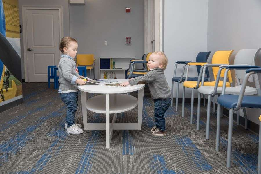 Young boys playing at the dentist office