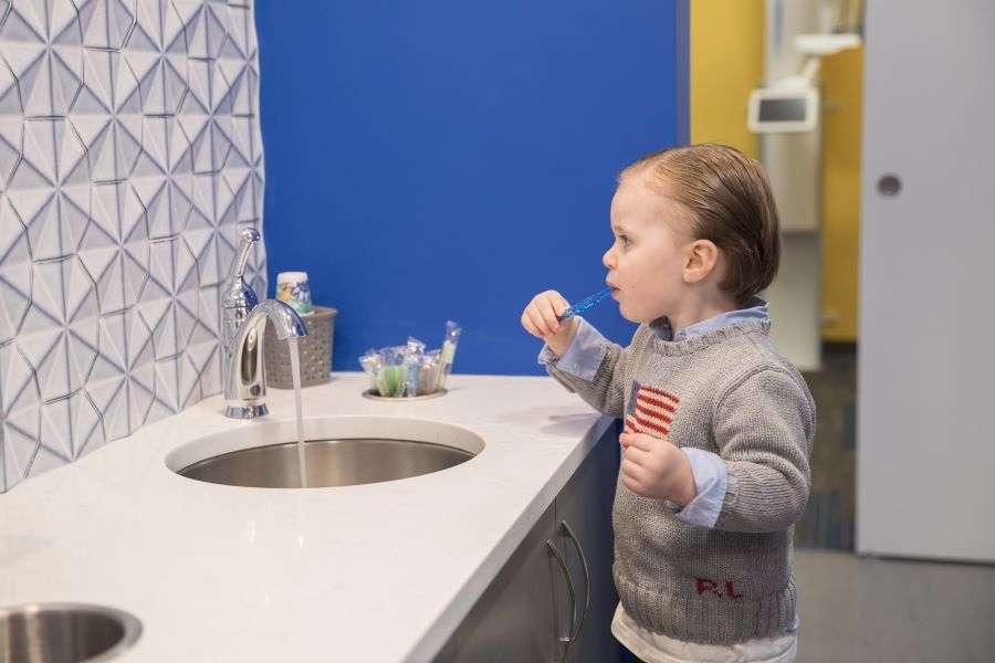 Young boy brushing his teeth