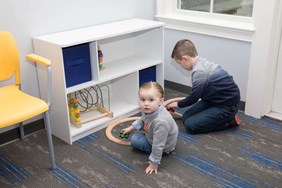 Boys playing at in the waiting room